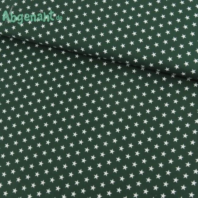Baumwollstoff bedruckt mit Sternen in dunkelgrün ballen